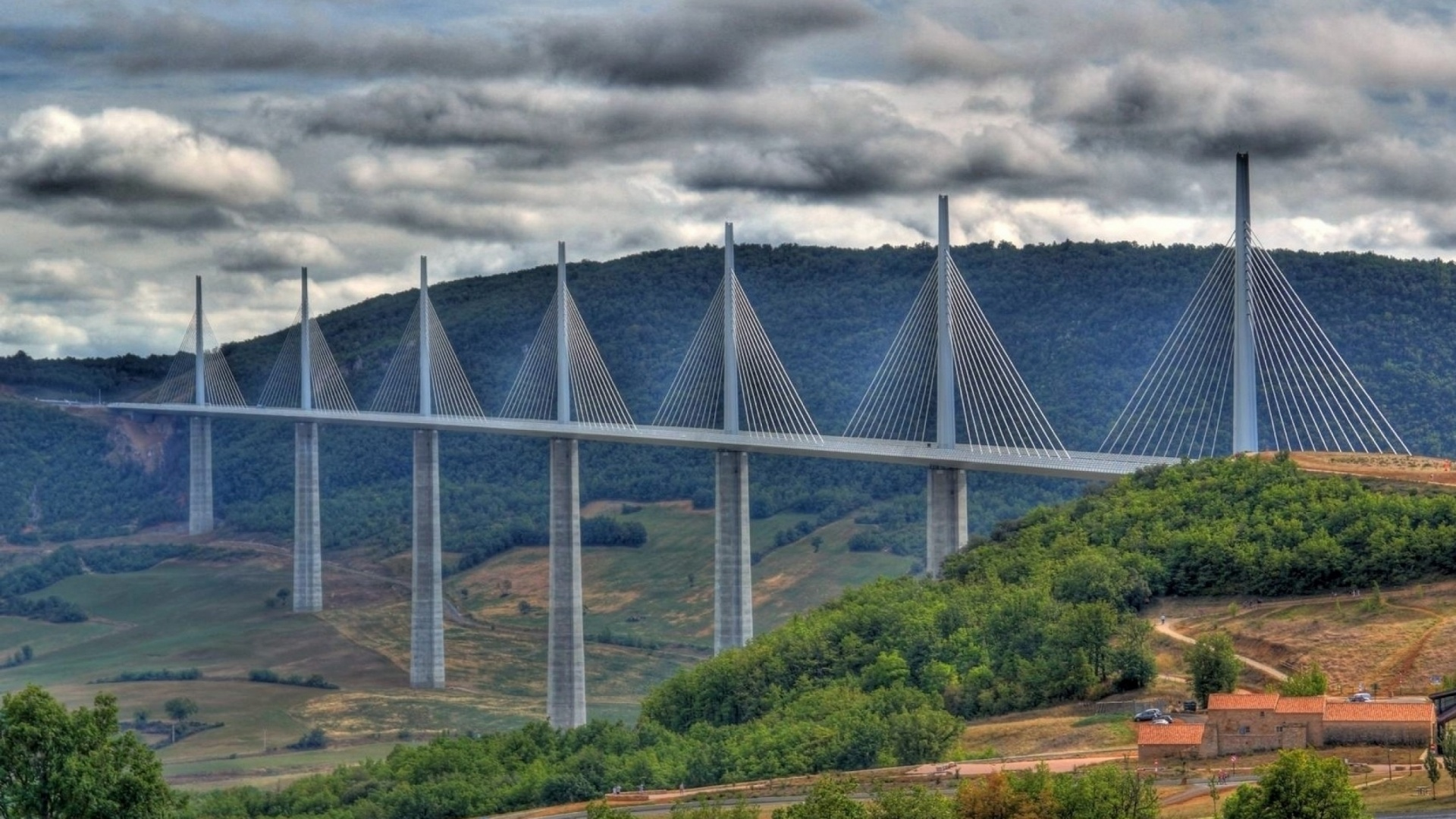 construction of millau viaduct world s tallest The incredible millau viaduct bridge was opened in december 2004 and is the highest bridge in the world, standing 270 meters (890 feet) over the tarn river and is more than 340 meters it is slightly taller than the eiffel tower in paris and only 38 meters (125 ft) shorter than the empire state building.